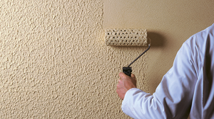 image of highbuild decorative finish being applied to a wall