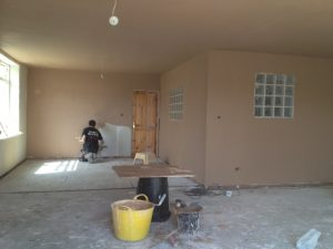 image plasterboarding and skimming a wall