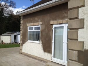 image showing house after having a sand and cement render repair