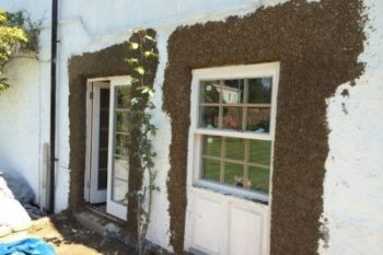 image of house with pebbledash render that has had a repair carried out