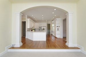 image of plaster arches through to a kitchen
